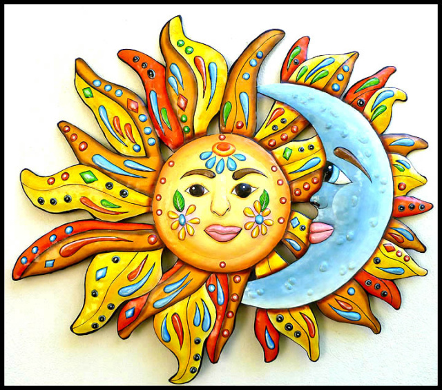 painted metal sun and moon wall hanging