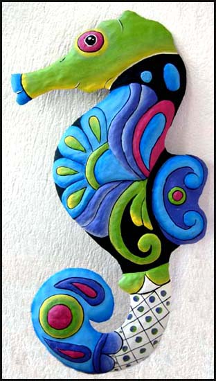 Beautifully hand painted metal seahorse tropical - nautical wall decor. Handcut from steel drums in Haiti.