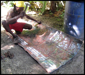 preparing recycled metal steel drum in Haiti - Haitian metal tropical designs . - www.tropicdecor.com