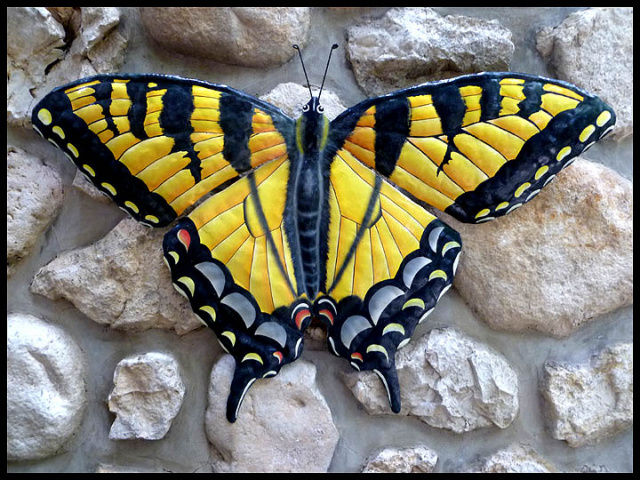 Painted metal butterfly wall hanging. Haitian steel drum metal art