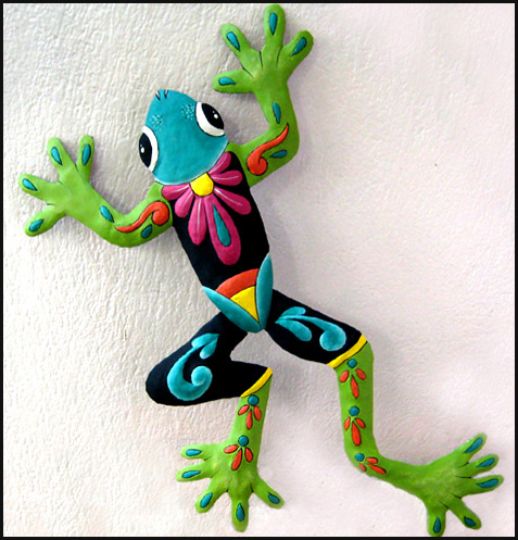 painted metal tropical frog wall hanging