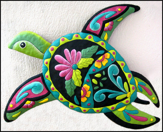Hand painted metal turtle design. Hand cut from recycled steel drums in Haiti.