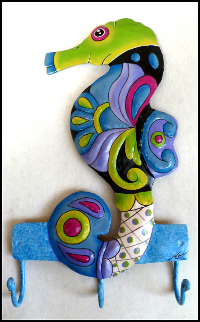 Hand painted metal seahorse wall hook.