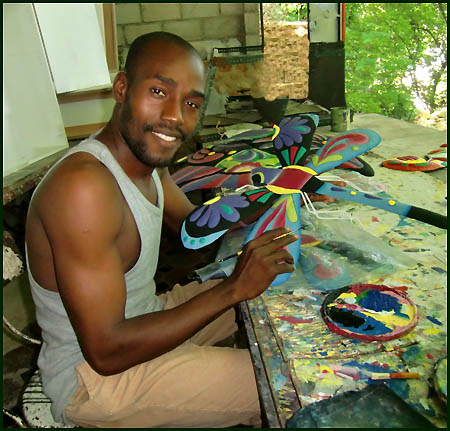 Haitian artist - Painting tropical metal art - Haitian steel drum art.. - www.tropicdecor.com