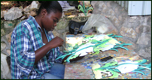 Haitian artist - Painting tropical metal art - Haitian steel drum art. - www.tropicdecor.com.